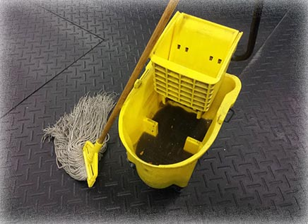 Dirty mop bucket in gym